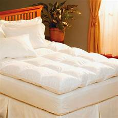 pacific coast feather bed topper added to a mattress for