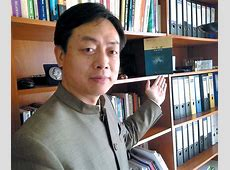 wang yiwei shows a sample of his new book given as a gift