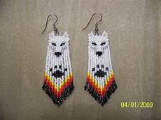 beadwork earrings seed bead white wolf style beaded earrings