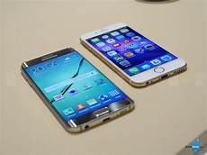 Samsung S6 Vs Iphone 6 Samsung Galaxy S6 Edge Vs Apple Iphone 6 First Look