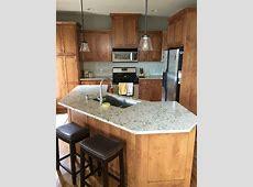 My updated kitchen! Cambria Windermere countertops, glass backsplash (random strip in sands