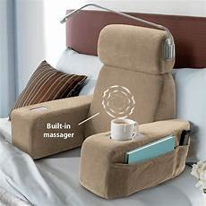 massaging sit up pillow with arms at brookstone buy now