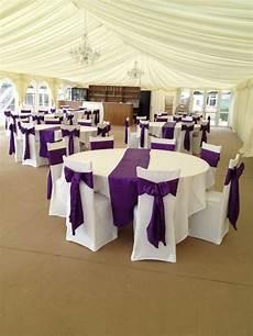 cadbury purple satin sashes with white covers like the