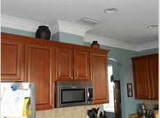 Kitchen Crown Molding work. if the cabinets have a gap between them and the ceiling, then we can