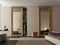 wardrobe with liscia sliding doors in corda color wood and