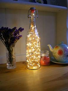 Fairy Lights In Glass Cylinder Glass Bottle Lamp Fairy Lights Bottle Wine Bottle Lamps Etsy