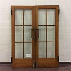 door swing swing door with brass door handles ca 1950s