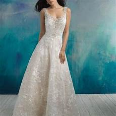 interwoven with gauzy blossoms this gown is embellished