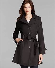 calvin klein trench coat hooded belted in black lyst