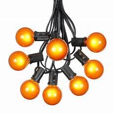 Orange Chasing Lights Orange G40 Globe Round Outdoor String Light Set On Black