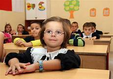 children in primary school on the day of classes in