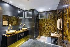 black and gold luxury bathroom completehome