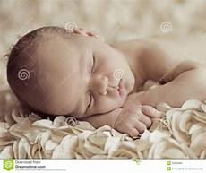 Baby Free Images Cute Sleeping Newborn Baby On Petals Royalty Free Stock