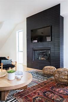 Back To Back Fireplace Design 8 Stunning Black Fireplace Makeovers You Can Copy