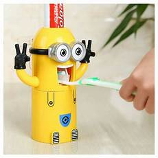 minnion toothpaste dispenser and brush holder minion