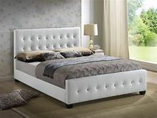g2587 upholstered bed in white leatherette by