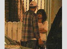 Ashton Kutcher and Mila Kunis share a smooch as they take
