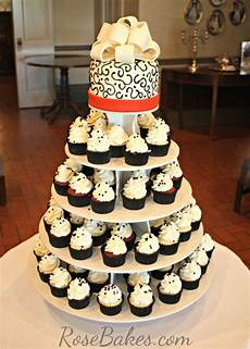 red black and white wedding cake and cupcake tower