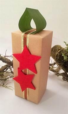 kerze i christmasgi geschenke verpacken