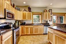 how to clean wooden kitchen cabinets which is the best way
