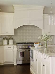 white kitchen cabinets with white backsplash neutral home interior ideas home bunch interior design ideas