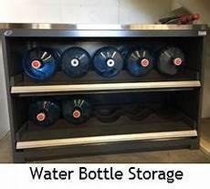 water bottle jug storage heavy duty rack pull out cabinet