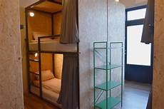 single enclosed bunk bed in 8 bed room hostels for