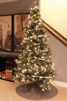 How To Wrap A Large Tree With Christmas Lights Seasonal Style My Christmas Tree Style Modern Graphic