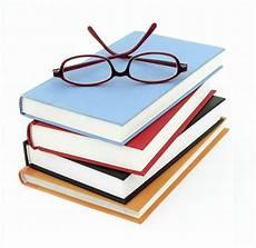 education books stack of books small glasses fairport central school