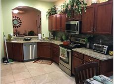 Giallo Ornamental Granite Countertops in Kitchen with Backsplash Tiles