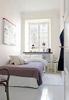 narrow bedroom design for with white interior color