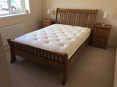 halo wentworth wooden sleigh bed with 2 bed side
