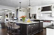 black distressed kitchen island white and gray kitchen with gold pendants and dip dyed