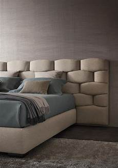 bed with upholstered headboard majal by flou