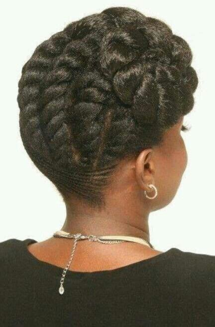 cornrows updo into buns hair cornrowed and then flat twisted into a side bun