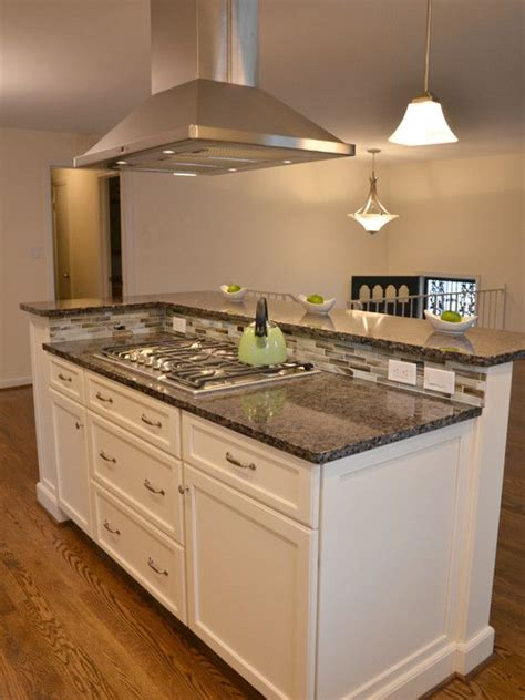 kitchen with stove in island white cabinetry kitchen with island by rjk construction