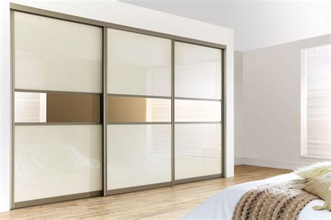 Make Your Own Fitted Wardrobes by Curved Bronze Frame With Pearl White Glass Bronze