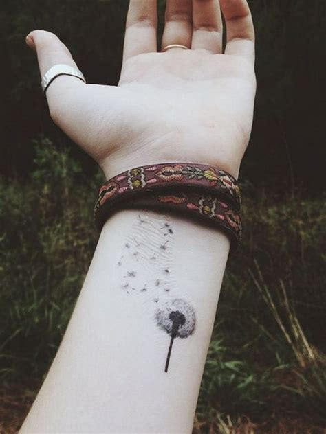 dandelion wrist tattoos 40 beautiful dandelion tattoos designs and meaning
