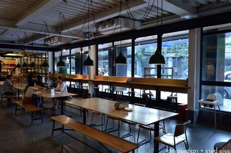modern canteen interior  polished wooden tables