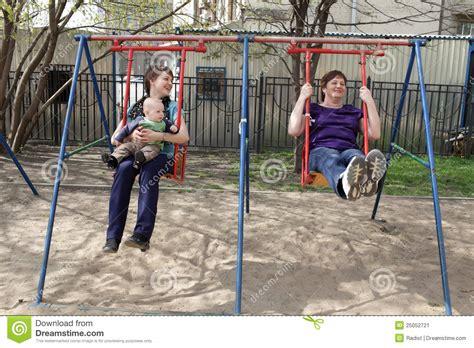 family swing happy family on swing stock image image 25052721