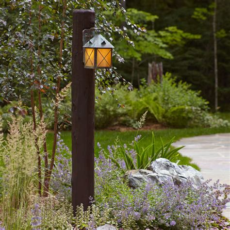 Low Light Bathroom Plants by Exterior Wall Light Mounted On Log Post Rustic Post