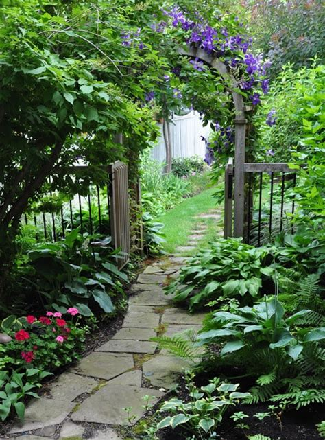 Garden Arbor Path Flagstone Garden Path And Clematis Covered Arbor Use