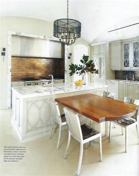 t shaped island marble trimmed via atlanta homes