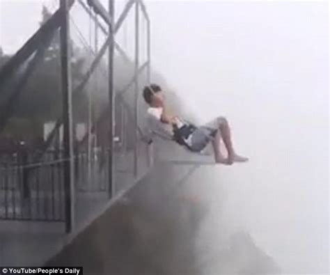 japan swing thrill seeker rides a swing on the edge of a 1 000 foot