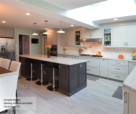 light grey kitchen with grey island cabinets