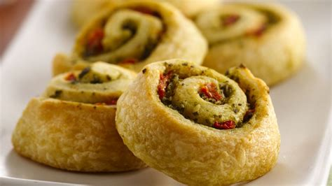 pinwheel recipes easy pesto pinwheels recipe from pillsbury com