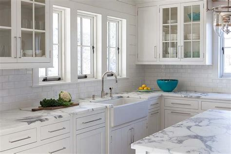 white kitchen cabinets with marble countertops calcutta gold marble kitchen countertops with white subway