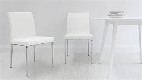 White Oval Dining Table And Chairs White Oval Extending Dining Table Quilted Faux Leather Dining Chairs