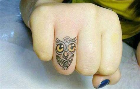 owl finger tattoo owl tattoos owl tattoos are popular here are