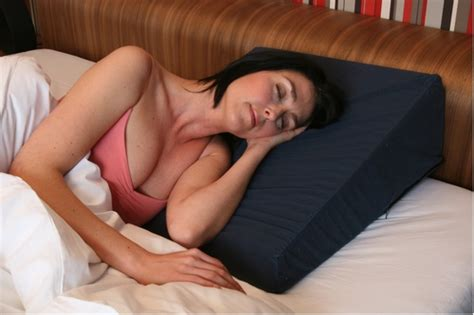 pillows to prop you up in bed stop the slips with a bed wedge pillow